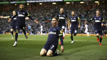 Derby's Harry Wilson (centre) celebrates scoring the team's third goal against Leeds.