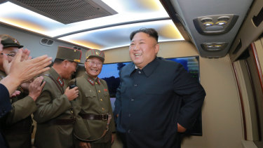 A picture provided by the North Korea government shows Kim smiling and celebrating with military officials.
