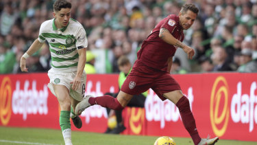 Celtic's Michael Johnston and Cluj's Ciprian Deac battle for the ball during the Champions League third qualifying round second leg match between Celtic and CFR Cluj, at Celtic Park.