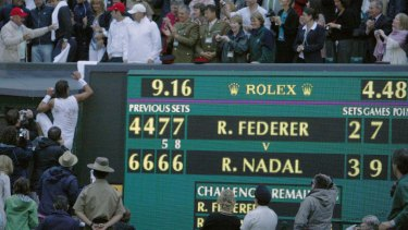 Classic match: Nadal climbs into the stands next to the scoreboard telling the tale in 2008.