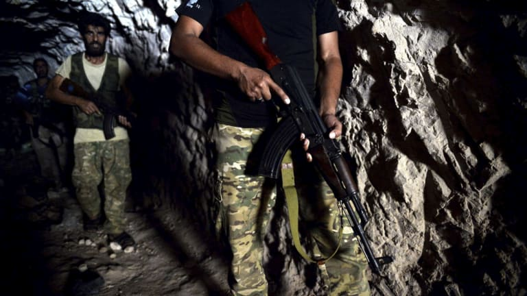 Fighters with the Free Syrian Army  hiding out in a cave on the outskirts of Idlib.