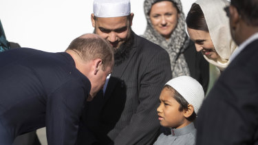 Prince William, left, meets a young Muslim community member and New Zealand Prime Minister Jacinda Ardern, second right, at the Al Noor mosque, on Friday.