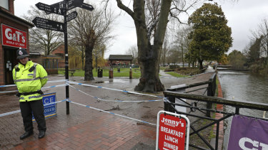 A police officer at a cordon near the Maltings in Salisbury, England, where Russian former spy Sergei Skripal and his daughter Yulia were found on a bench after they were attacked with a nerve agent.