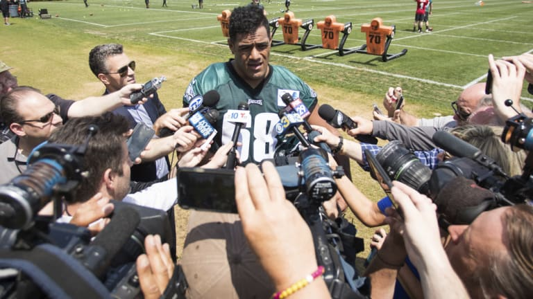 Centre of attention: Jordan Mailata is tackled by a media scrum after making the Eagles' final roster.