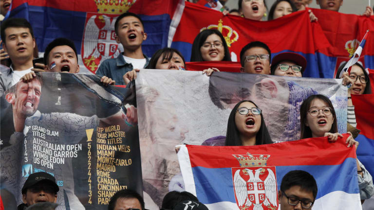 Fans of Serbia's Novak Djokovic cheer during the men's singles quarterfinals.