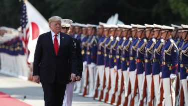 US President Donald Trump inspects an honour guard during a welcome ceremony at the Imperial Palace in Tokyo, Japan, on Monday.