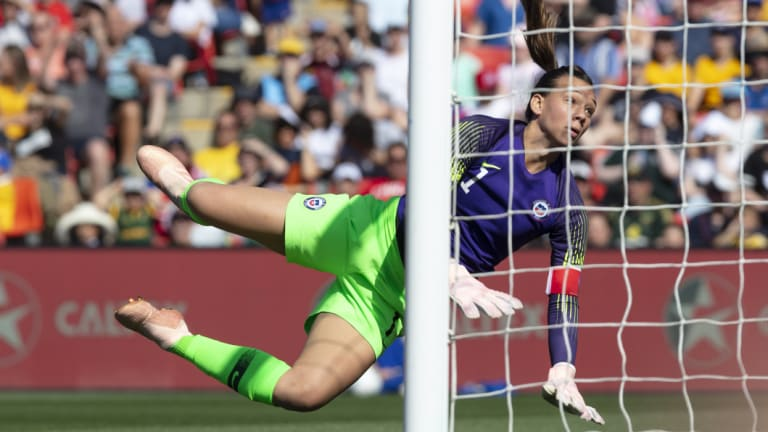 Heroic: Christiane Endler dives to deflect the ball in a match-defining performance for the visitors.