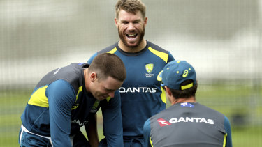Ready to roll: Warner shares a joke with Josh Hazlewood and Mitchell Starc in the nets at Lord's.