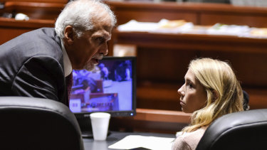 "Brooke ""Skylar"" Richardson, right, talks to attorney Charles H. Rittgers in the courtroom before closing arguments."