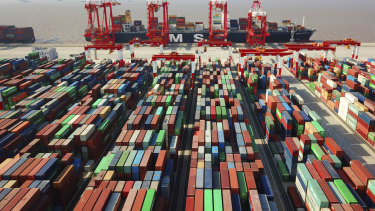 A trade war is dividing the US and China. A cargo ship is docked at the Yangshan container port in Shanghai, China.