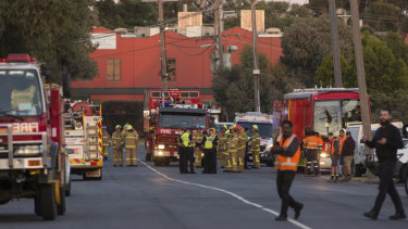 Firefighters at the factory in Thornycroft Road, Campbellfield.