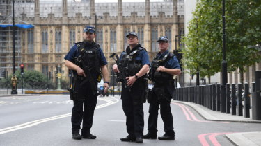Armed police on Victoria Embankment in Westminster, after a car crashed into security barriers outside the Houses of Parliament, in London.