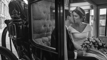 Princess Eugenie and Jack Brooksbank embrace, in the Scottish State Coach, upon its return to Windsor Castle following the Carriage Procession.