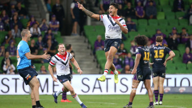 Walking on air: Latrell Mitchell breaks the deadlock for the Roosters.
