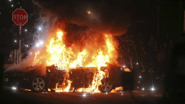 A car burns after petrol bombs were thrown at police in Creggan, Londonderry.