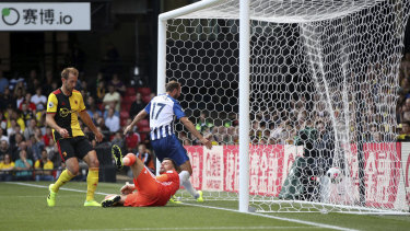 Own goal: A cross by Brighton and Hove Albion's Pascal Gross ends up in the net after being turned in by Watford's Abdoulaye Doucoure.