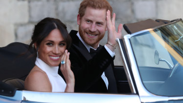 The newly married Duke and Duchess of Sussex in the E-Type Jag.