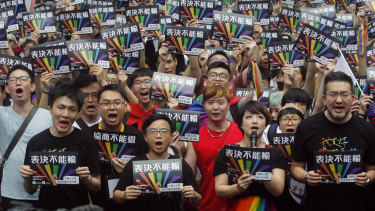 Same-sex marriage supporters gather outside the Legislative Yuan in Taipei for the decision.