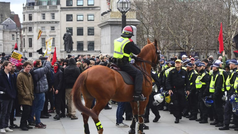 Police attempt to keep rival Brexit protest groups from clashing in central London on Sunday.