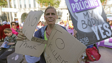 A woman protests against a demonstration by pro-abortion campaigners.