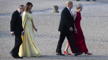 Donald Trump, Theresa May, front and Melania Trump, and May\'s husband Philip, arrive at Blenheim Palace on Thursday.