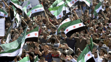 Protesters attend a demonstration against the Syrian government's expected offensive to Idlib, in the northwestern town of Maarat al-Numan,  south of Idlib, Syria, on Friday.