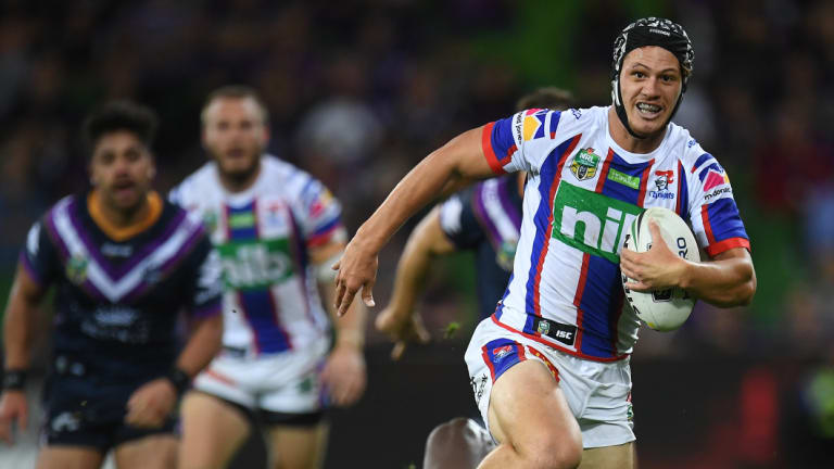 Dynamo: Newcastle fullback Kalyn Ponga breaks into the clear against Melbourne, only to lose the ball in a Billy Slater tackle.