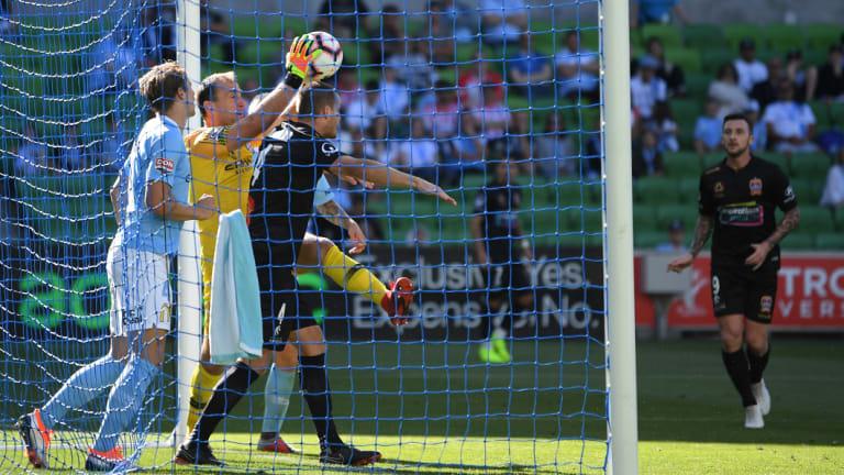Goal-line scramble: City keeper Eugene Galekovic grabs a clean take under pressure.