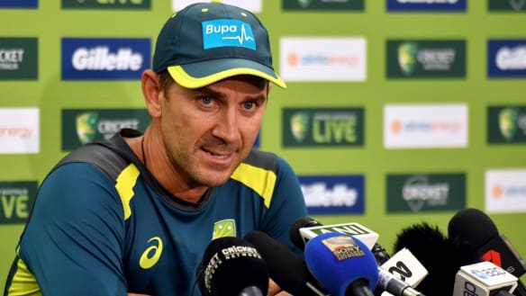 Australian coach Justin Langer speaking at a media conference.