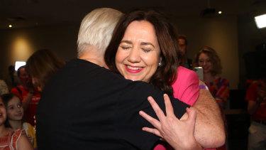 Annastacia Palaszczuk shares a hug with her father, former Labor minister Henry Palaszczuk, after winning her third term as Queensland premier.