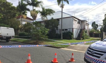 The Queenslander, converted into a set of units, in Annerley where the male victim and the woman lived.