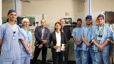 Frecklington, flanked by some of the extensive team of doctors, nurses and technicians who performed her marathon surgery.