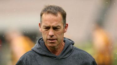 Hawks coach Alastair Clarkson will miss Friday night's state-of-origin bushfire relief match.