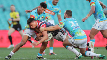 Joseph Manu goes over for the Roosters.