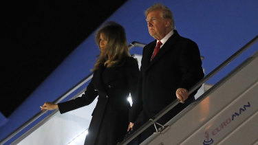 President Donald Trump and first lady Melania Trump alight from Air Force One, after arriving at Orly airport near Paris.