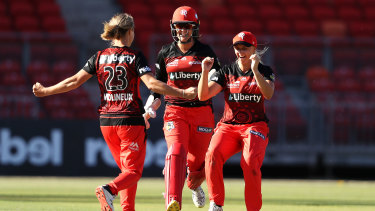 Renegades bowler Sophie Molineux celebrates with Josie Dooley (left) and Amy Yates after the win.