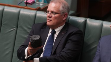 Prime Minister Scott Morrison with a lump of coal during question time at Parliament House in Canberra last year.