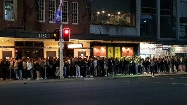 The line outside The Golden Sheaf in Double Bay on Wednesday night.