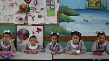 Girls sit inside a classroom at an UNRWA school during the first day of a new school year in Gaza City.