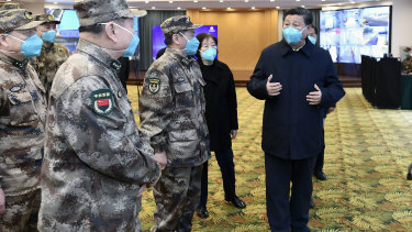 Chinese President Xi Jinping, right, is briefed in Wuhan on Tuesday.