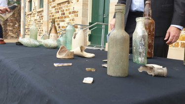 Artefacts from early Brisbane found at the $3.6 billion Queen's Wharf Brisbane development site, presented in front of the Commissariat Store and preserved by the project team.