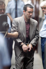 Jason Roberts is led into court during his murder trial in December 2002.