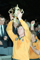Nick Farr-Jones celebrates with the Webb Ellis Cup at Twickenham in 1991.
