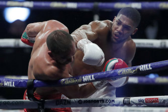 Anthony Joshua lands a blow on challenger Kubrat Pulev.
