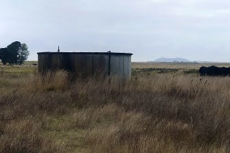 Where once stood the heart of a community - a hall and tennis courts - only a water tank remains, the volcanic upthrust of Mount Rouse in the distance.