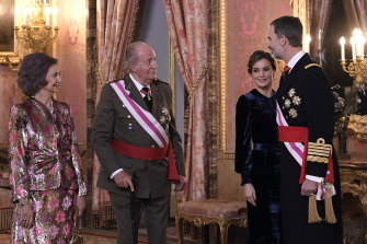 From left, former Spanish queen Sofia and king Juan Carlos, speak to his son King Felipe, right, and his wife Queen Letizia in 2018.