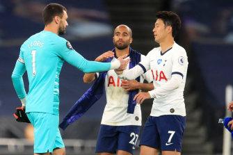 Hugo Lloris of Tottenham Hotspur confronts teammate Heung-Min Son.
