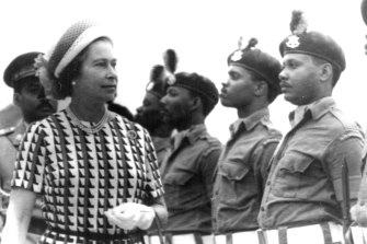 Queen Elizabeth inspects a guard of honour as she arrives in Bridgetown, Barbados on the final visit during her Silver Jubilee tour in 1977.