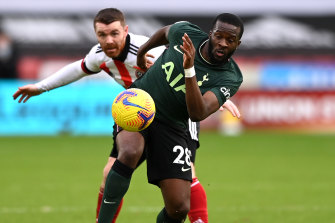Tottenham's Tanguy Ndombele in action against Sheffield United's John Fleck.