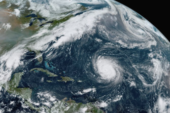 Hurricane Teddy in the Atlantic, centre; tropical depression 22 (Alpha) in the Gulf of Mexico, left; the remnants Paulette, top right; and Wilfred, lower right.